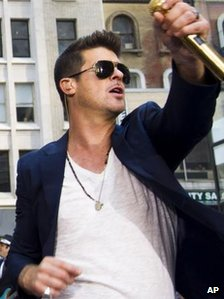 Robin Thicke, performing Blurred Lines in New York