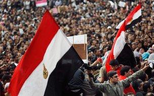 Protester holding Egypt flag