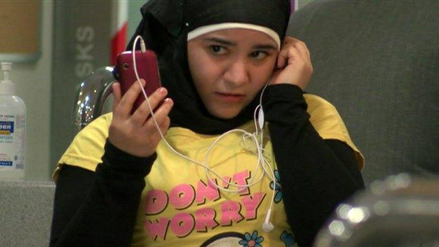 Jordanian girl using mobile phone