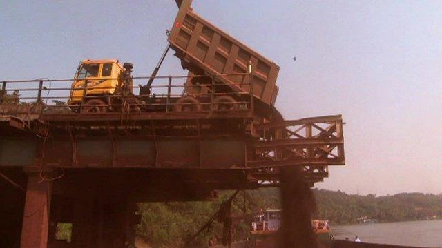Dumper truck tipping sand
