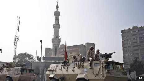 Egyptian Army soldiers stand guard outside the Rabaah al-Adawiya mosque, 16 August 2013