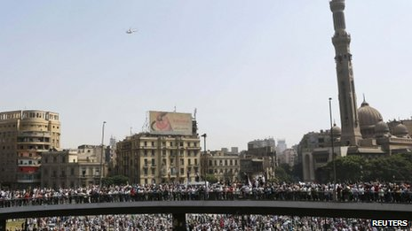 A military helicopter flies above supporters of ousted Egyptian President Mohammed Morsi, in Cairo 16 August, 2013.