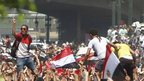 Supporters of deposed Egyptian President Mohamed Mursi shout slogans and wave Egyptian flags during a protest outside Al-Fath Mosque in Ramses square in Cairo