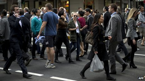 Pedestrians cross an intersection Sydney on June 13, 2013
