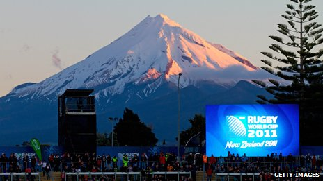 Mt Taranaki behind a big screen showing a match in 2011's Rugby World Cup