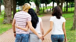 Man holding hands with two women