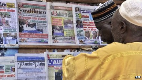 People look at newspapers on display at a newsstand on 12 August 2013 in Bamako, Mali