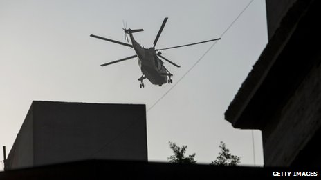 An Egyptian military helicopter flies over central Cairo during fighting near Ramses Square on 16 August, 2013.