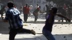Protesters who support ousted Egyptian President Mohammed Morsi clash with opponents outside Azbkya police station near Ramses Square in Cairo, 16 August, 2013.