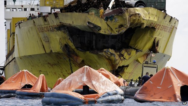 A cluster of life rafts floats near the cargo ship Sulpicio Express Siete Saturday Aug 17, 2013, a day after it collided with a passenger ferry in central Philippines