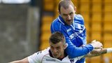 St Johnstone's Dave Mackay towers over Ross County's Graham Carey