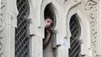 A protester who supports ousted Egyptian President Mohamed Morsi looks through a window of the al-Fath mosque on Ramses Square in Cairo (17 August 2013)