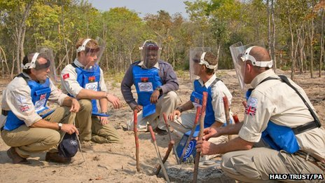 Prince Harry in Angola with HALO Trust officials in August 2013