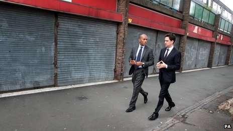 Labour leader Ed Miliband with shadow business secretary Chuka Umunna on a south London estate