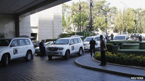 UN vehicles transporting a team of United Nations chemical weapons experts arrive in Damascus on 18 August 2013