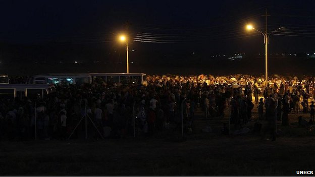 Night-time shot of new refugees arriving at the makeshift reception in Iraqi Kurdistan