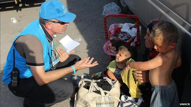 UNHCR official speaks to family of refugees