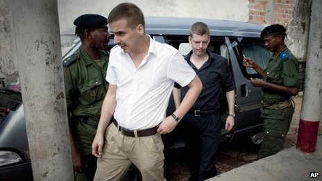 Norwegian citizens Tjostolv Moland, left, and Joshua French, right, arriving for their trial process in Kisangani, Congo, ion 3 December 2009