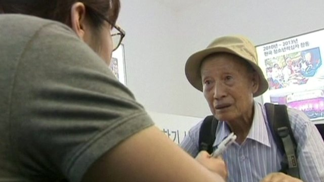 Man registering for family reunion