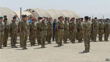 Undated handout photo issued by the MoD of the flag ceremony in Camp Bastion to mark the relocation of the headquarters of Task Force Helmand from Lashkar Gah