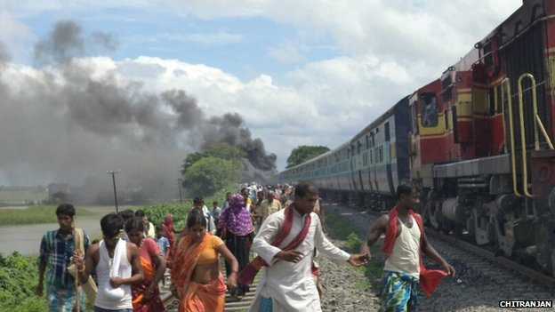 People running away from the site of the train accident in Bihar on Monday 19 August 2013