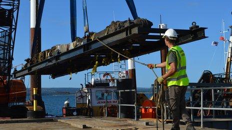 Swash wreck rudder being brought ashore