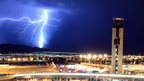 Lightning flashes behind an air traffic control tower at McCarran International Airport in Las Vegas, Nevada, on 18 August 2013.