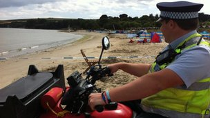 A policeman surveying the beach