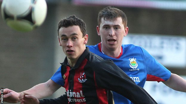 Paul Healey of Crusaders and Linfield's Billy Joe Burns