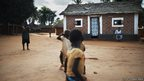 Children infront of a house in Obo, Central African Republic