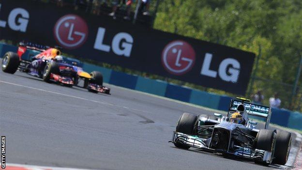 Sebastian Vettel and Lewis Hamilton (front)