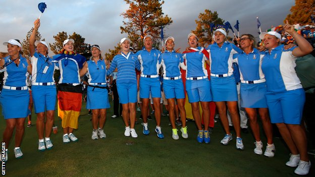 Members of the European Team celebrate after defeating the United States 18-10 in the 2013 Solheim Cup