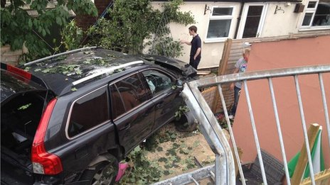 The car crashed into a garden