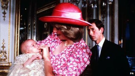 Princess Diana holds baby Prince William, as Prince Charles looks on