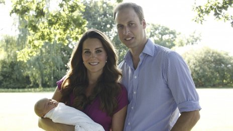 The Duke and Duchess of Cambridge sitting in a garden with their baby, Prince George
