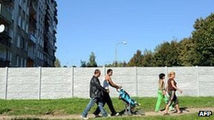 Roma walk past segregation wall in Michalovce, eastern Slovakia, 4 Oct 10