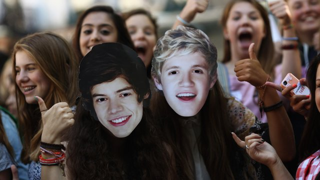 One Direction fans in Leicester Square wearing Harry and Niall masks.
