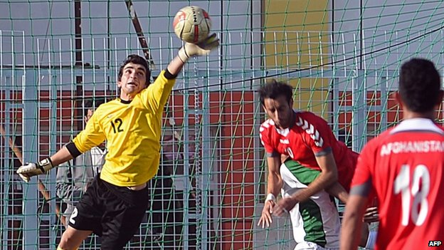 Pakistani goalkeeper Saqib Hanif makes a save during the game