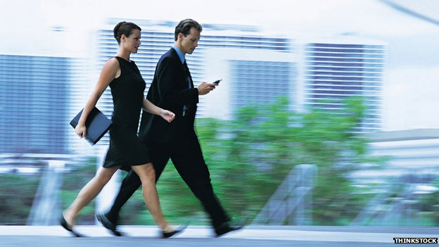 A businessman and businesswoman walking