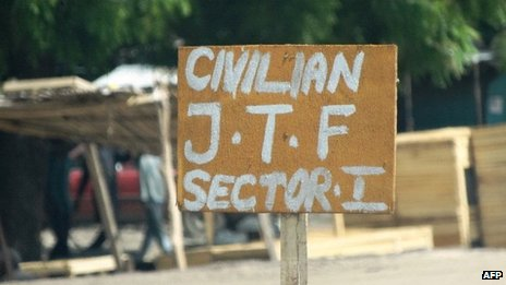 A sign near a checkpoint in Maiduguri of a vigilante group reads Civilian JTF or Civilian Joint Task Force - 19 July 2013