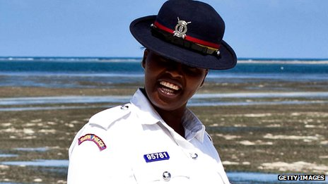 A Kenyan police officer patrols a beach in Mombasa