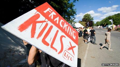 """Protester's placard saying """"fracking kills"""""""
