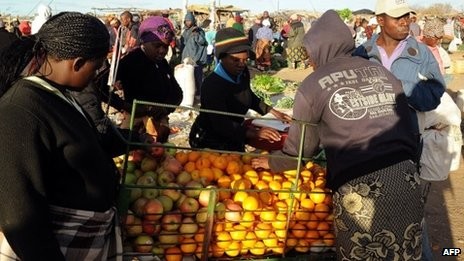Zimbabwean women shop for vegetables in Jambanja market in Seke, 58km south of Harare - 2 August 2013