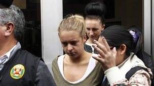 Police escort Michaella McCollum Connolly, of Ireland, left, and Melissa Reid, of Britain, in handcuffs as they are moved from the National Police anti-drug headquarters to a court to be formally charged for drug trafficking in Lima
