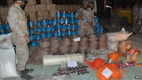 Pakistani paramilitary soldiers stand beside seized bomb-making material in Quetta on 20 August 2013.