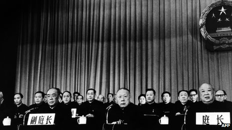Special Court President Jiang Hua (R) reads the verdict during the Gang of Four trial on 26 January 1981 in Beijing. Mao Zedong's widow Jiang Qing and Zhang Chunqiao received death sentences that were later commuted to life imprisonment, while Wang Hongwen and Yao Wenyuan were given life and 20 years in prison, respectively. They were all later released.