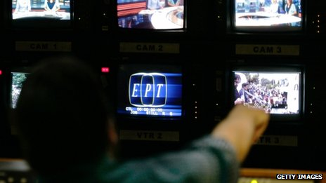 An employee of the state broadcaster ERT works in the control room during an online news bulletin broadcast at the corporation's headquarters during a 24-hour general strike on 13 June, 2013 in Athens, Greece.