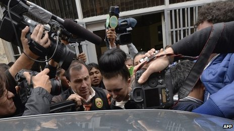 Michaella McCollum being escorted out of the public prosecutor's office in Callao, Peru, on 20 August 2013 to be taken to the district court