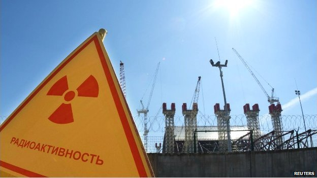 A radiation sign outside a power plant