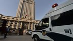 A police van arrives at the Intermediate People's Court where disgraced politician Bo Xilai will soon go on trial in Jinan, Shandong province on 20 August 2013
